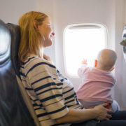 Baby on Mom's lap on the plane