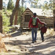 Family walking toward cabin