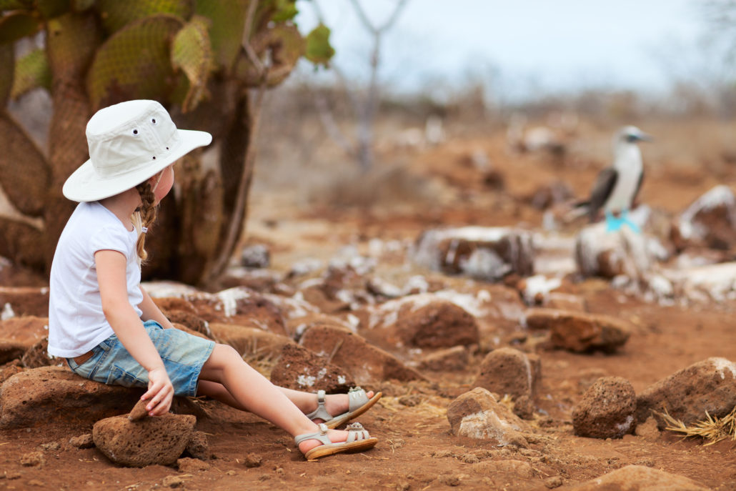 little girl looking at wildlife on Galapagos Islands