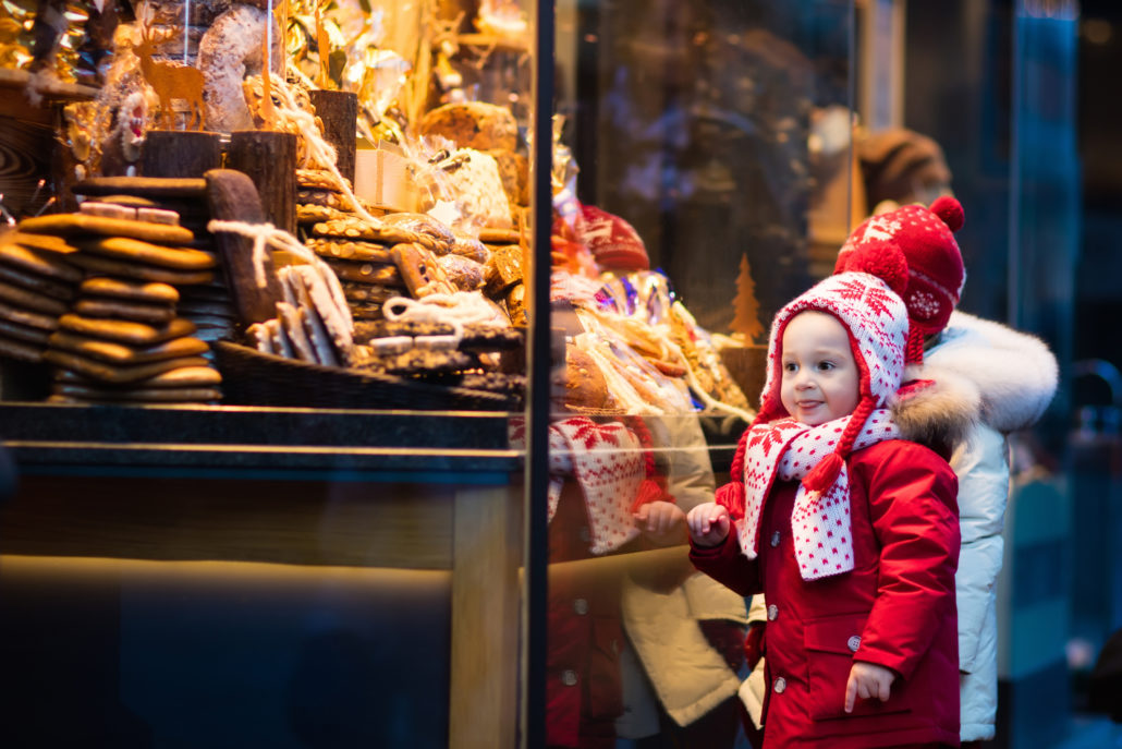 Little girls window shopping in Munich, Germany