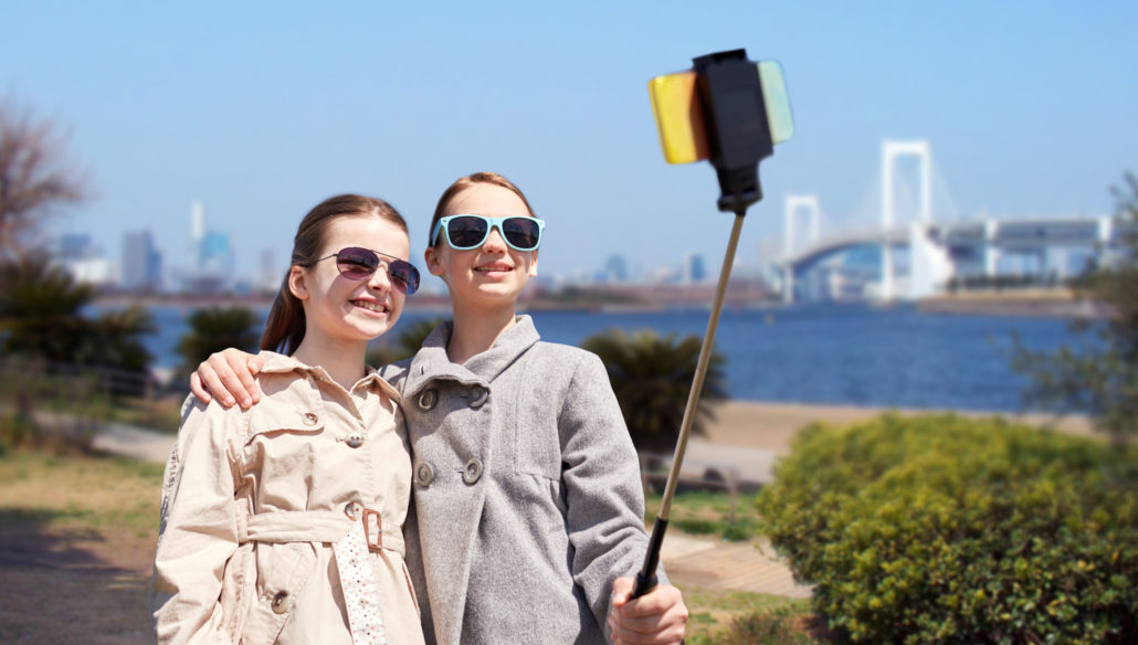 Young girls taking a selfie in Tokyo, Japan