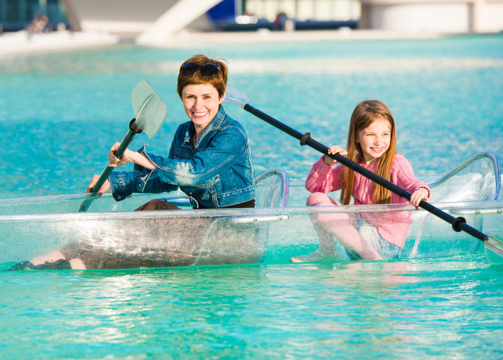 Mother and Daughter Kayaking in a clear boat
