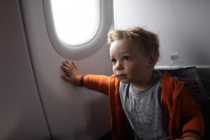 Toddler in seat on a plane