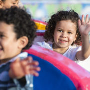 Kids on ride at amusement park