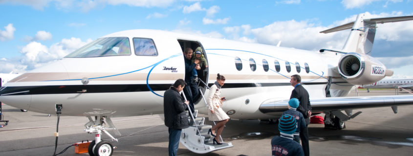 Family Leaving Private Jet