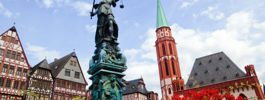 Old town in Frankfurt, Germany, with view of the statue Justitia on the Römerberg and old Old town in Frankfurt, Germany, with view of the statue Justitia on the Römerberg and old framework houses