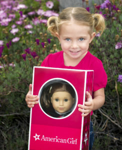 Toddler with American Girl Doll