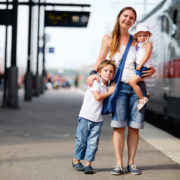 mother and kids wait for train