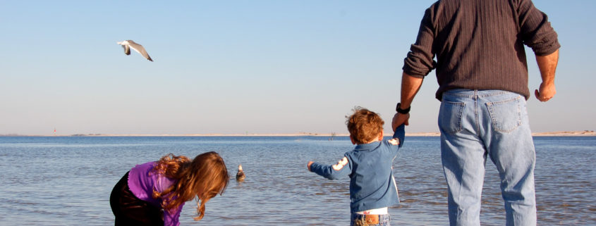 Father and children on beach in Pensacola, Fl