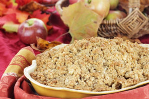 Freshly baked apple crisp with fresh apples and autumn