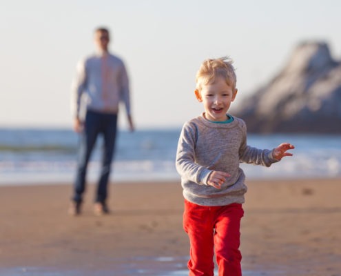 Father and son on Beach in California