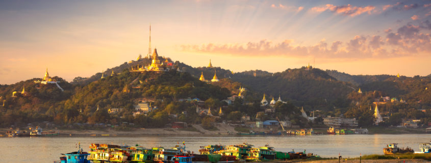 boats on the Irrawaddy River in Mandalay, Myanmar