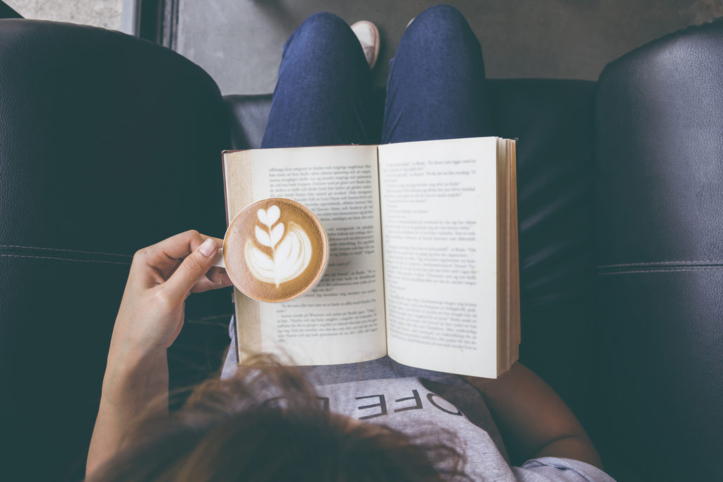 Girl reading with coffee