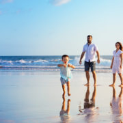 family on beach for holiday vacation