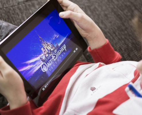 Kid watching iPad on the road