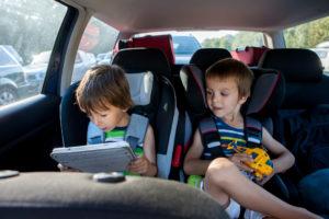 Kids in car playing