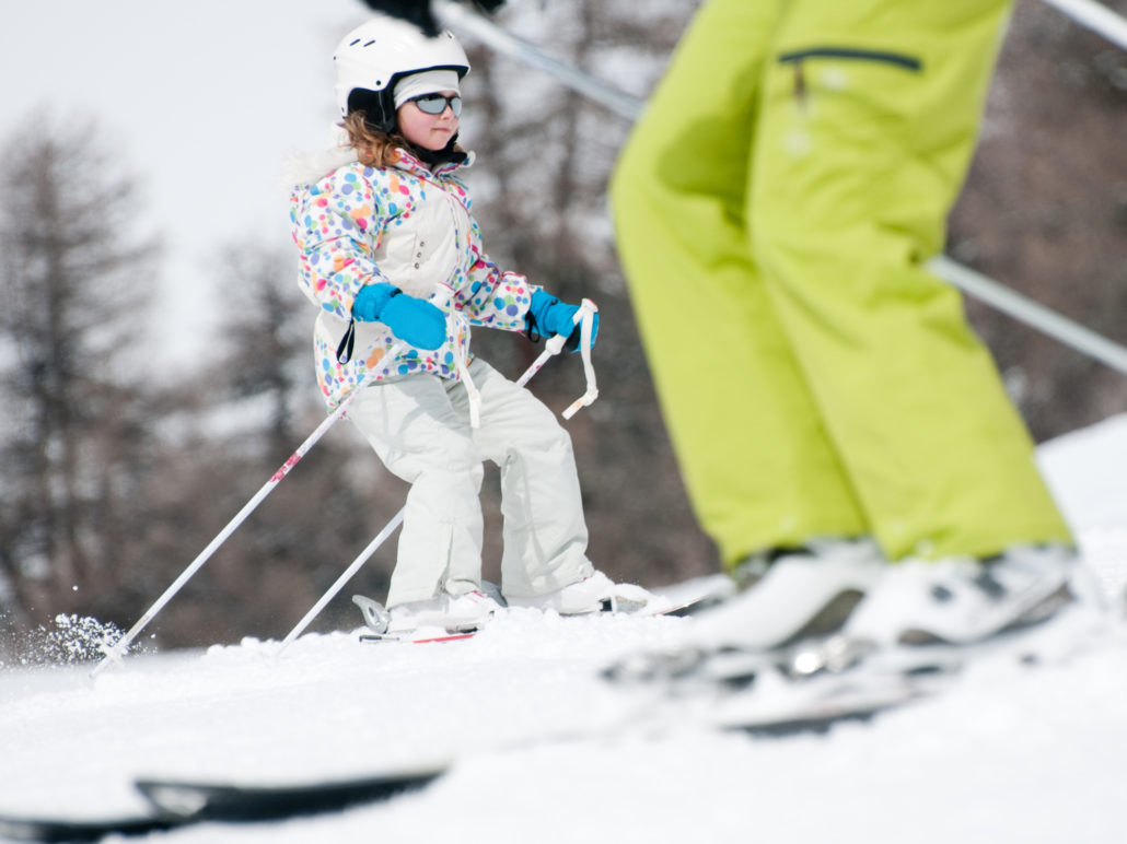 Family skiing on slopes