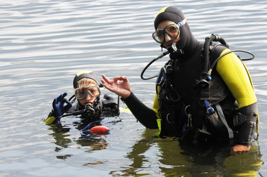 Scuba Diving Lesson with kid and instructor