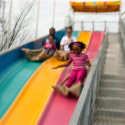 Family sliding at park