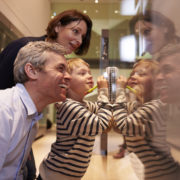 family in museum looking in glass case
