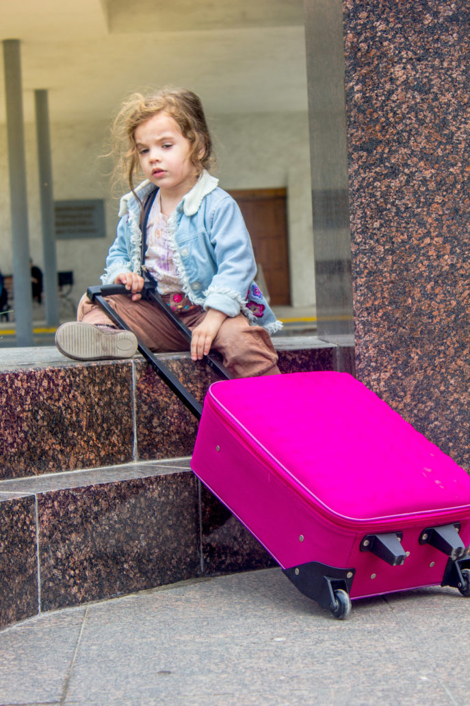 kid girl with travel suitcase