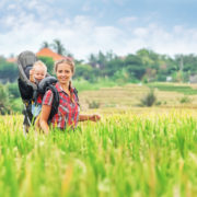 mother and baby in rice field
