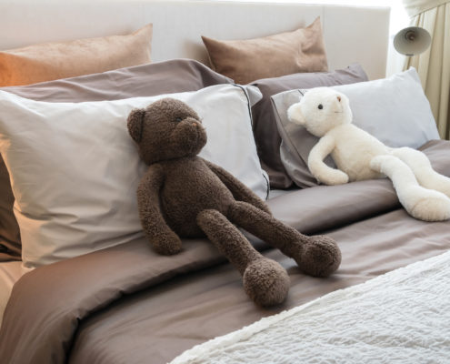 toys on hotel bed