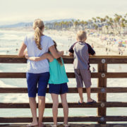 Family on pier in Southern California, beach