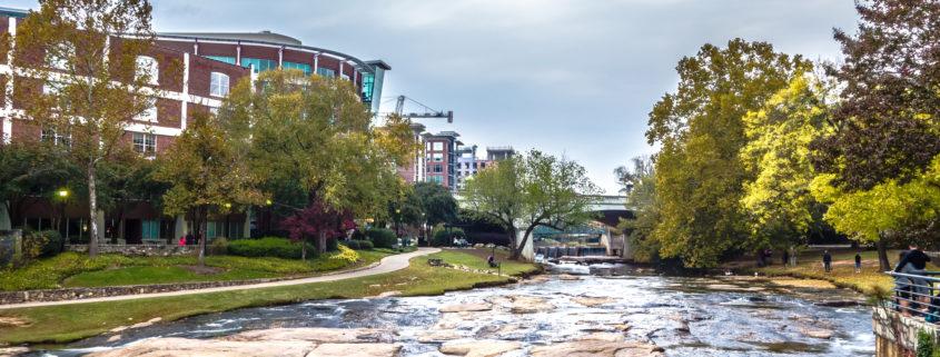 Street scenes around falls park in greenville south carolina. Buildings, cascades.