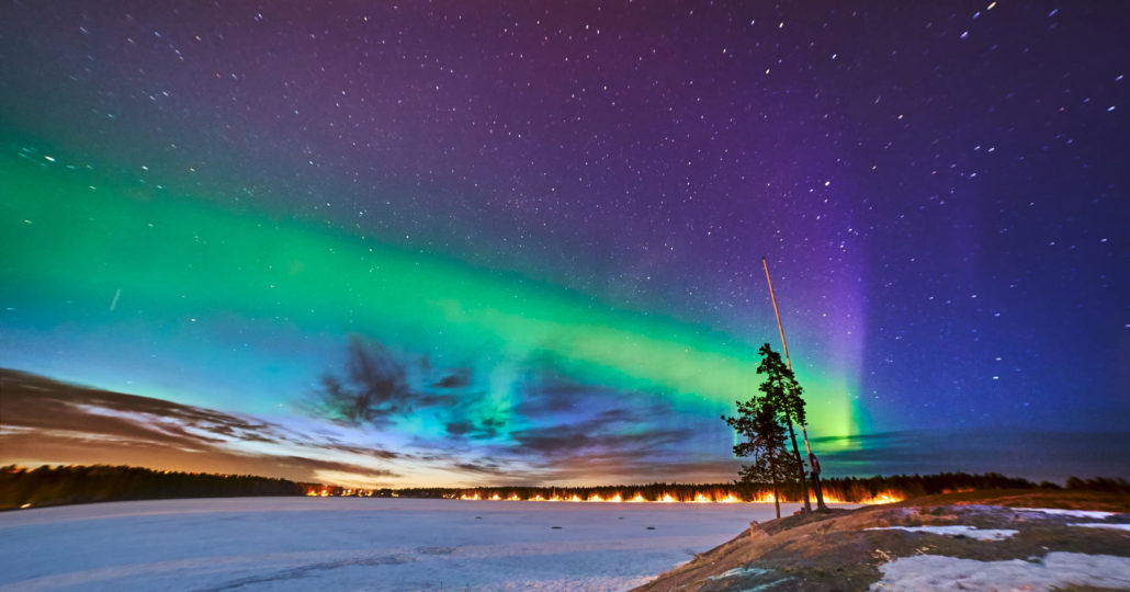 Northern lights over frozen lake in Sweden Umea