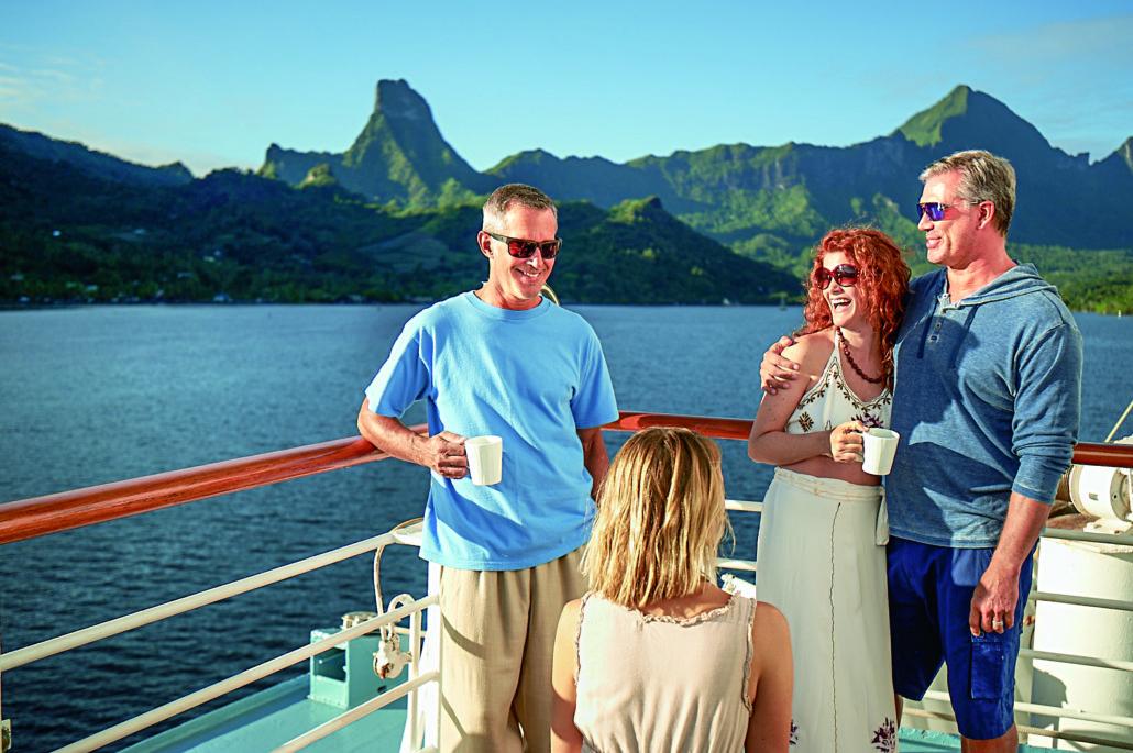 guests on Windstar deck with coffee