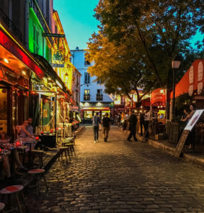 Nighttime on a busy Montmartre street on the Place du Tertre, Paris, France