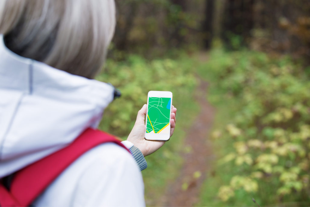 Woman using navigation app on smartphone