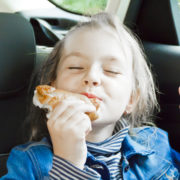 girl sitting inside car eating