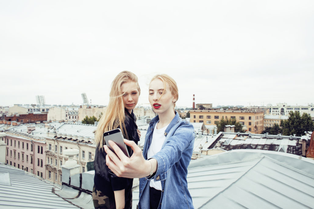 sisters taking selfie on roof top, travel
