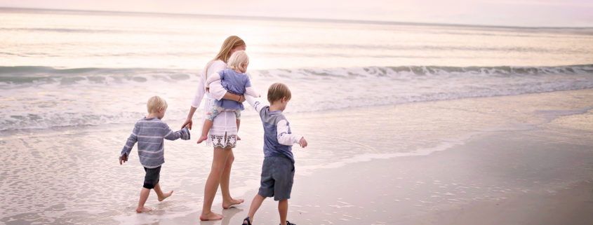 family walking on the beach in Marco Island, Florida
