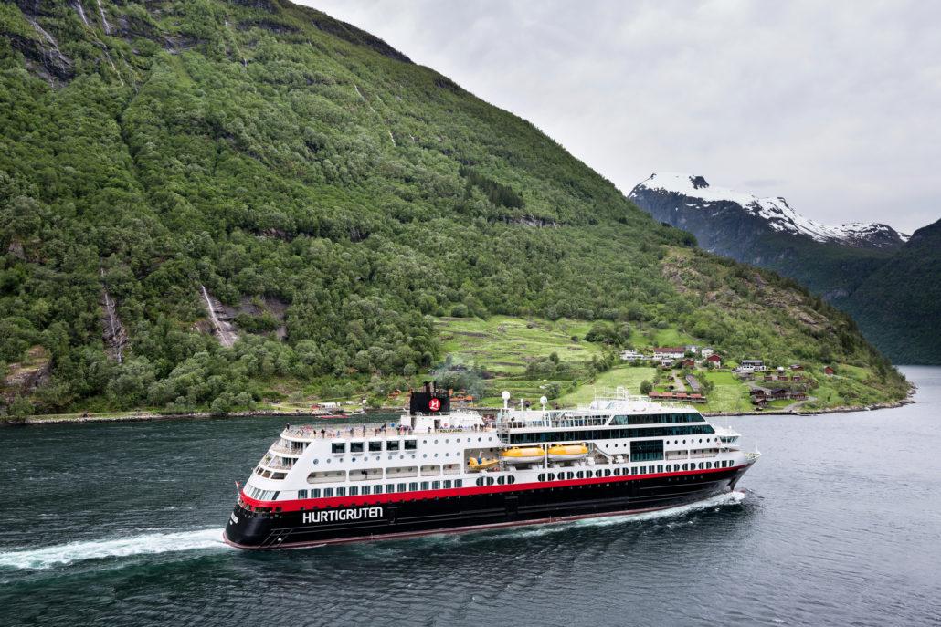Hurtigruten coastal vessel TROLLFJORD in the Geirangerfjord, Norway. Norwegian, geiranger.