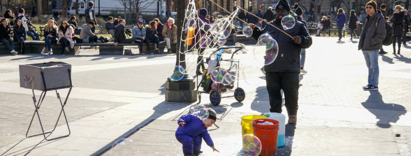 Kids having fun with blow Bubbles in Manhattan, New York City.