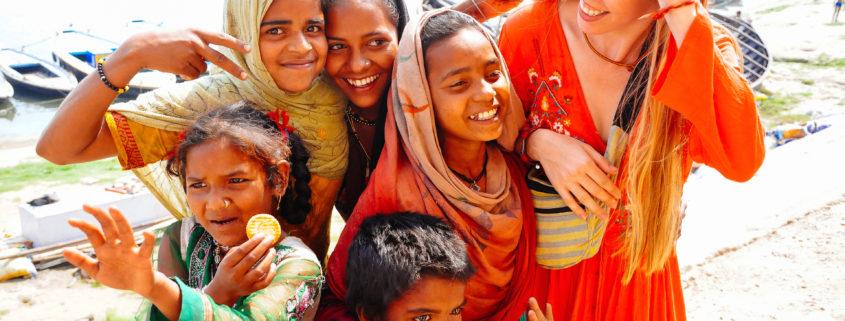 Locals embrace a tourist in Varanasi, India