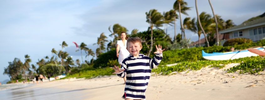 Cute toddler running on a tropical beach