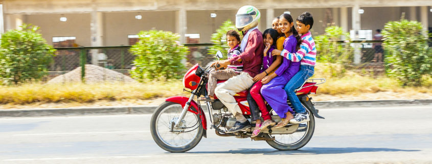Family traveling in India on Scooter