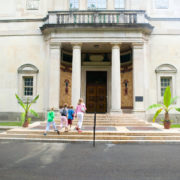Mother and kids walking into Barnes Foundation Museum in Philadelphia, Pa