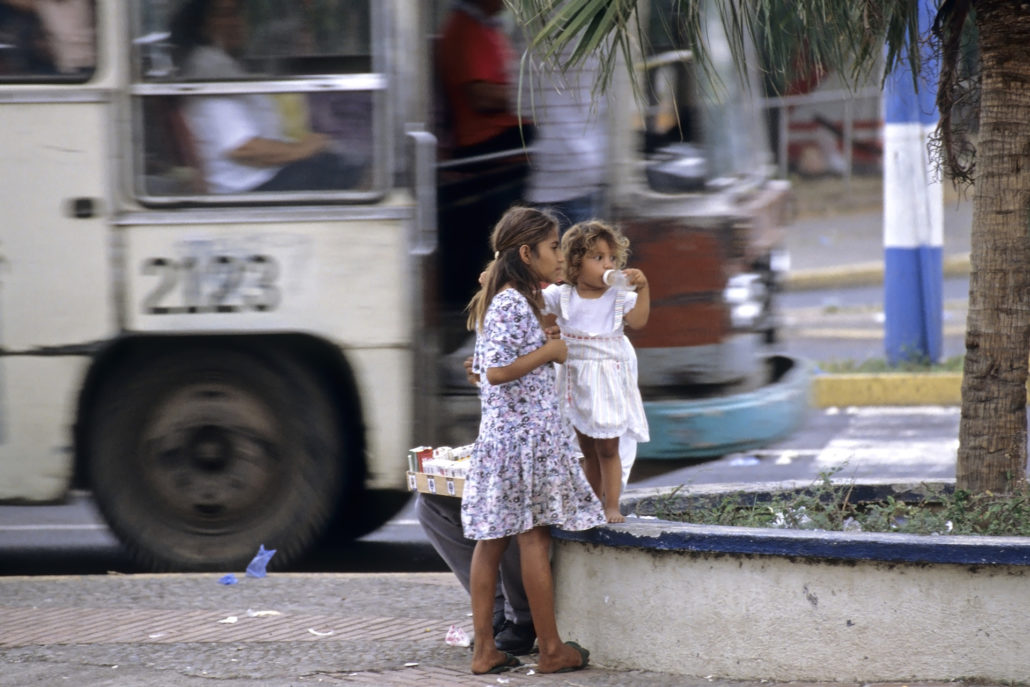 Managua street view, street children and city bus