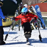 disabled skier attend to junior ski race