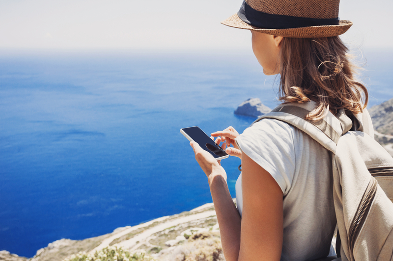 hiking kid using mobile phone