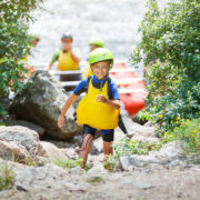 boy in helmet and life vest ready for rafting