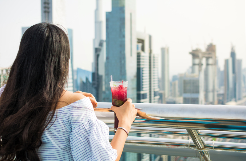Girl having a drink with Dubai