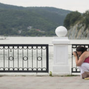 Mother Photographing Daughter © Nikolay Antonov | Dreamstime.com