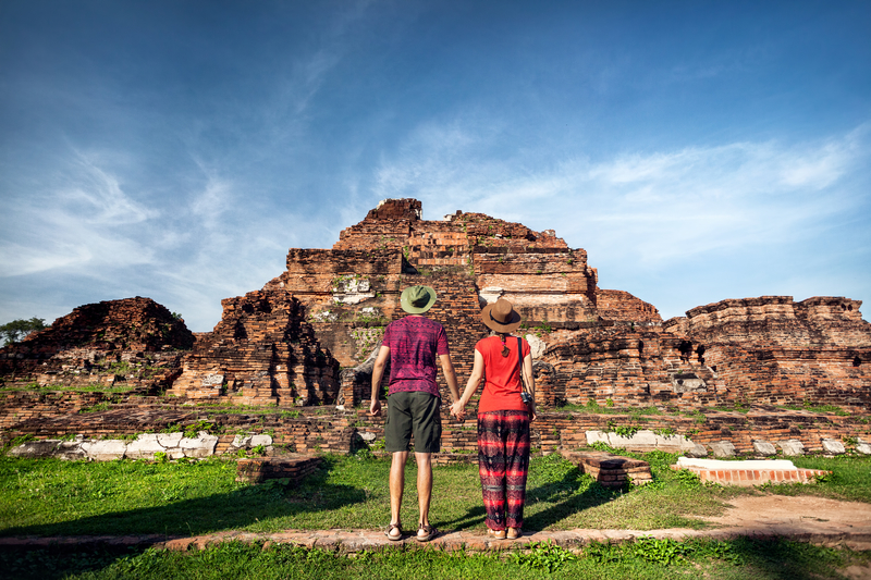 Couple visiting ruins in Thailand