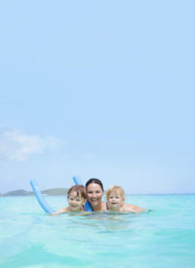 Family swimming in Riviera Maya, Mexico